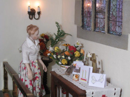Esther checks the flowers she has arranged for Pentecost Sunday morning service.