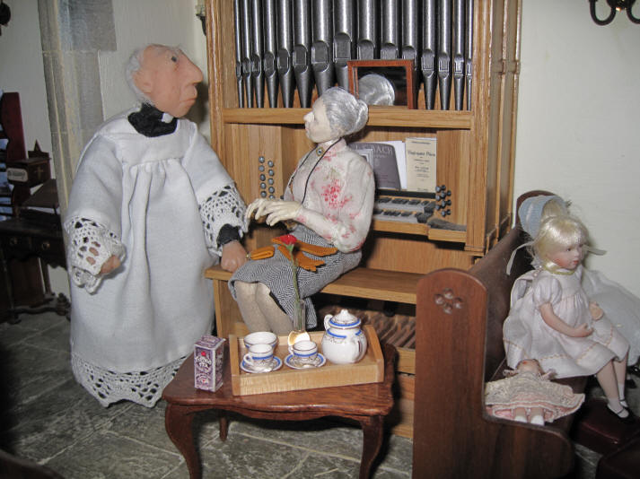 Miss Enid is telling the vicar that she has made him a lovely cup of tea in her very own bone china teapot!